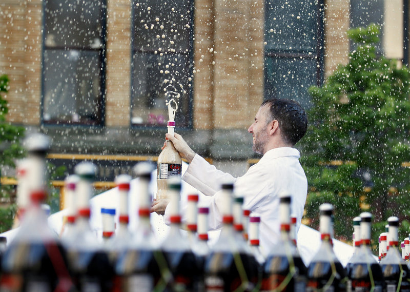 EepyBird co-founder Fritz Grobe of Buckfield is drenched in soda during the EepyBird Coke and Mentos Spectacular in Monument Square Thursday evening.