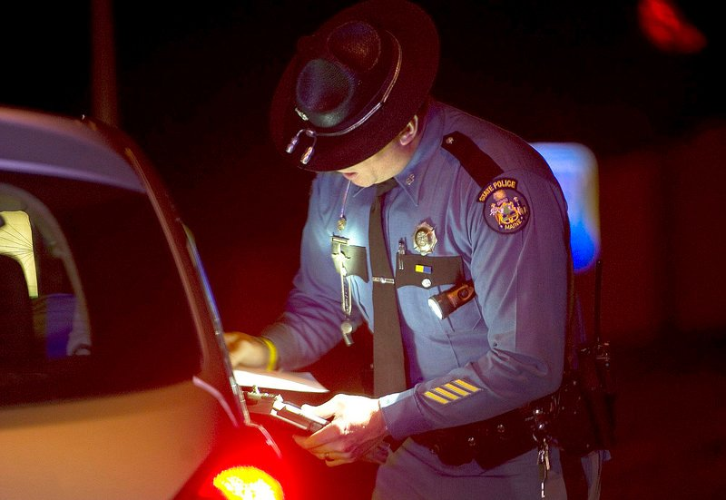 A state trooper makes a traffic stop on I-295 last year. Cutbacks have increased demands on law enforcement.