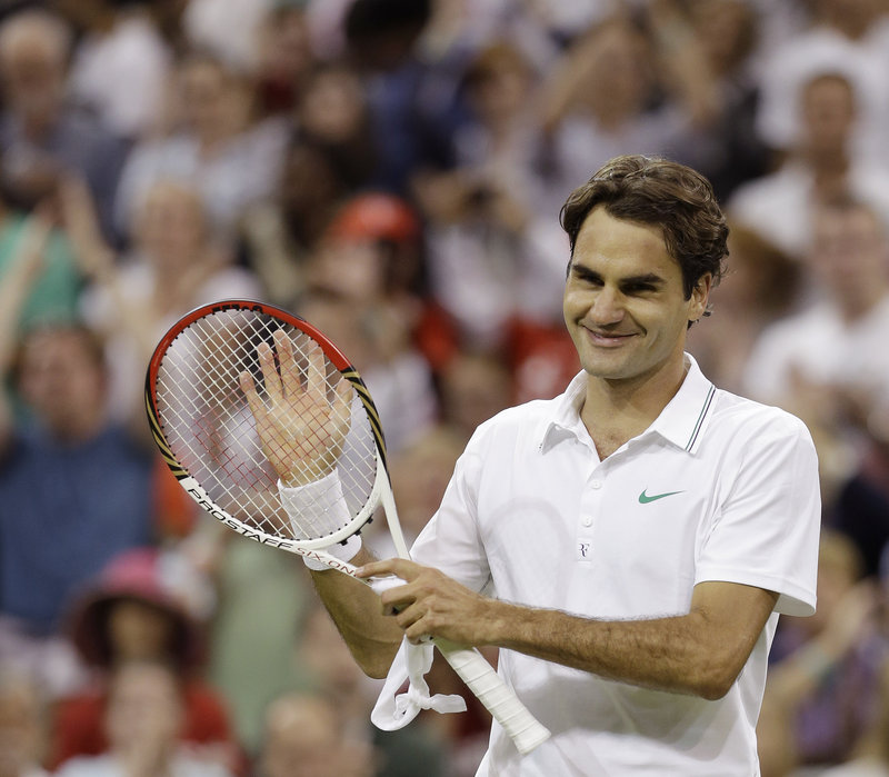 Roger Federer of Switzerland acknowledges cheers after winning his third-round match against Julien Benneteau of France at Wimbledon on Friday. Federer was two points away from losing six times against Benneteau.