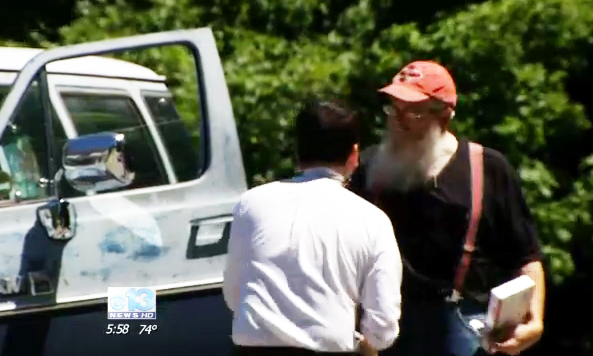 This screen image from a WGME-TV news segment shows reporter Steve Roldan, left, with David Houston of Bridgton.