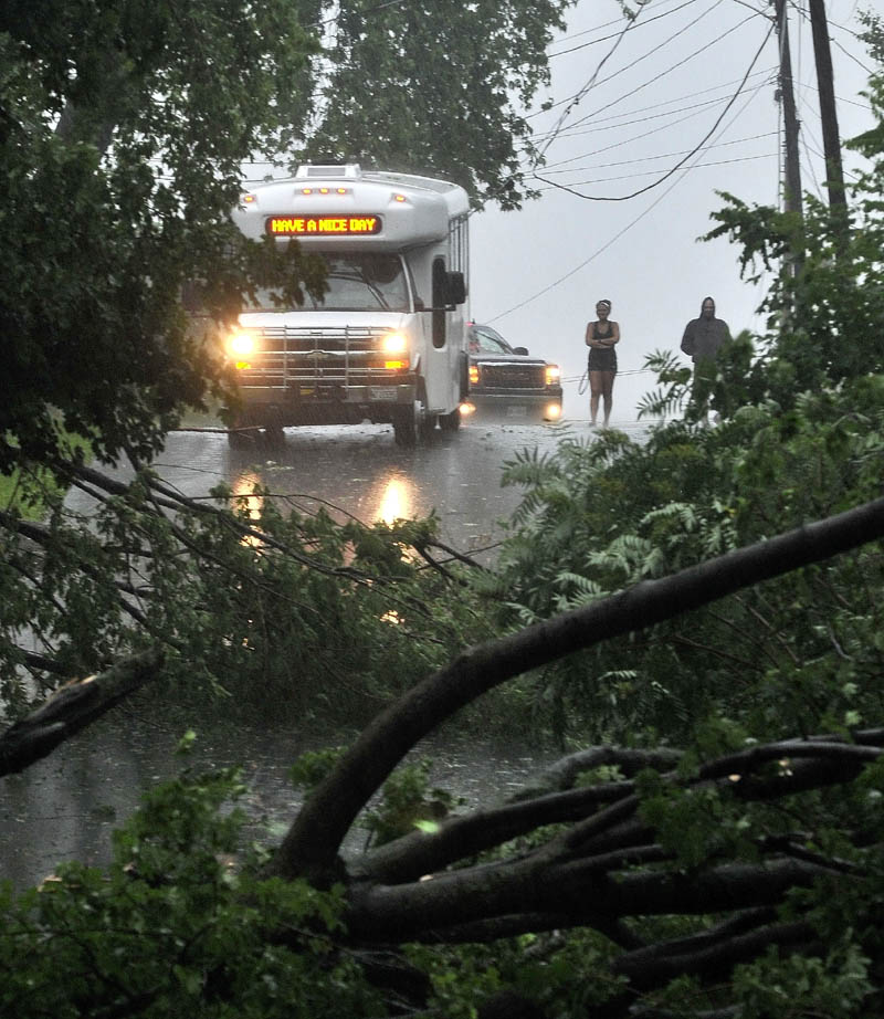 A Kennebec Valley Community Action Program bus was trapped by fallen power lines and a downed tree on Abbott Street in Waterville during the storm Friday.