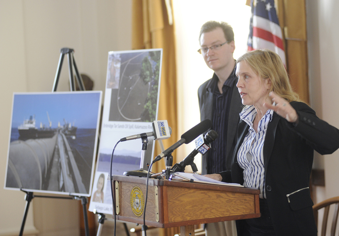 Shelley Kath of the National Resource Defense Council speaks at a news conference at City Hall in Portland today. The council released a report that details threats of a proposed pipeline that would bring tar sands oil from Canada to Maine.