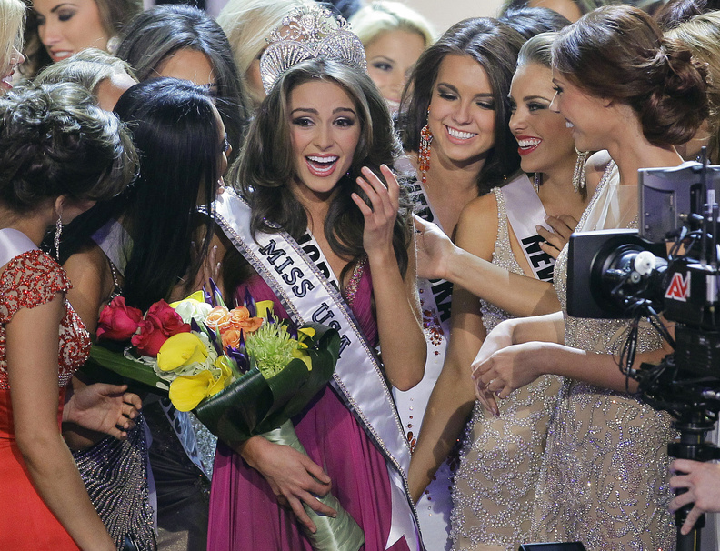 Miss Rhode Island Olivia Culpo, center, is surrounded by fellow contestants after being crowned Miss USA during the 2012 Miss USA pageant Sunday in Las Vegas.