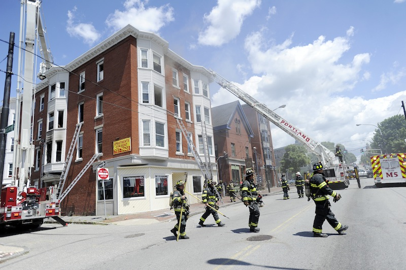 The fire department battles a fire at 229 Congress Street and 8 Montgomery Street in Portland on Monday, July 2, 2012.