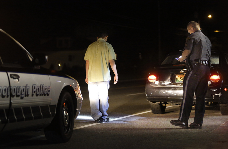 Scarborough police Sgt. Tom Chard conducts a sobriety test on a driver on Route 1 in Scarborough this month. The man passed the sobriety test. It's clear that higher-volume prosecutors' offices are prioritizing their caseloads and allowing some OUI defendants to plead to lesser charges.