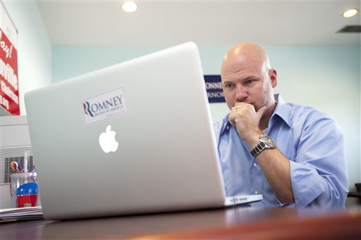 In this photo taken June 29, 2012, Matthew Gagnon volunteers working on a Facebook page for the Romney Victory Office in Fairfax, Va. Call them passionate, idealistic, earnest, even a tad naive: The volunteers helping to power the Obama and Romney campaigns are outliers at a time when polls show record low public satisfaction with government and a growing belief that Washington isn�t on their side. While motivated by opposing goals, the Obama and Romney volunteers share at least one key trait: an abiding faith in the political process and a belief that it still matters who occupies the White House. (AP Photo/Jacquelyn Martin)