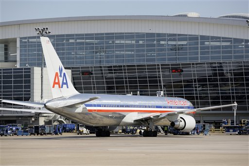 This June 29, 2011 file photo, shows an American Airlines aircraft at a Terminal D gate at Dallas-Fort Worth International Airport, in Grapevine, Texas. A new industry forecast about a possible pilot shortage in the U.S. is a safety concern.