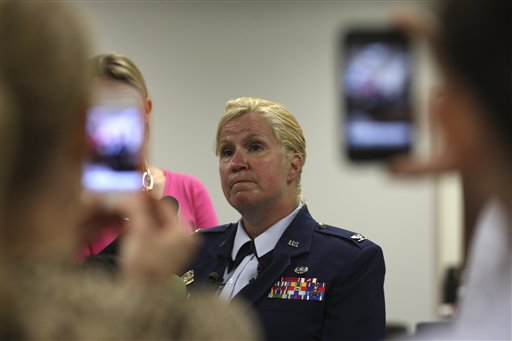 Staff Judge Advocate Col. Polly Kenny holds a news conference before the start of the court-martial of U.S. Air Force Staff Sgt. Luis A. Walker at Lackland Air Force Base, Monday, July 16, 2012 in San Antonio. Walker, a former training officer, is charges with illicit sexual contact with 10 female trainees. He is facing 28 counts including rape and is one of 12 instructors under investigation. (AP Photo/The San Antonio Express-News, Jerry Lara)