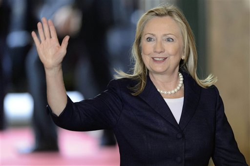 Secretary of State Hillary Clinton arrives for a meeting of the Action Group for Syria on Saturday at the United Nations' European headquarters in Geneva, Switzerland.