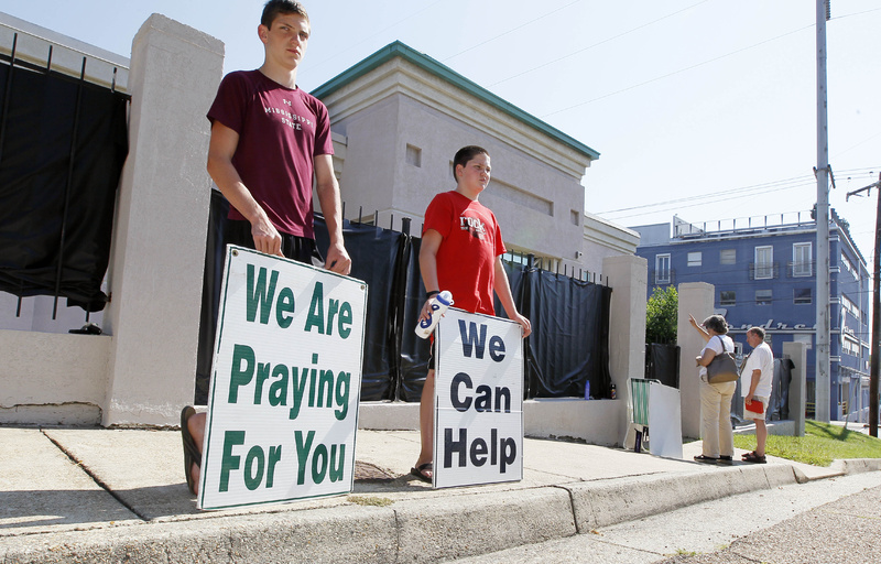 "Opponents of abortion stand outside Mississippi's only abortion clinic, singing and praying for their patients, and ""counseling"" them to reject abortion."