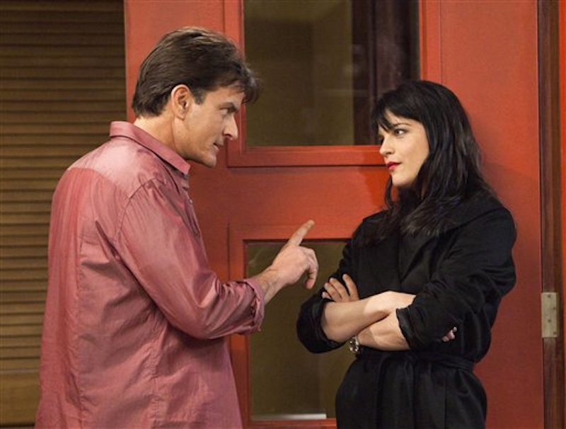 This file publicity image provided by FX shows Charlie Sheen as Charlie Goodson and Selma Blair as Kate Wales in a scene from the new comedy