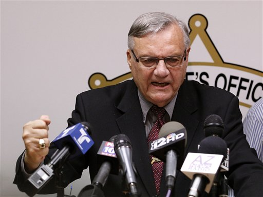 A defiant Maricopa County Sheriff Joe Arpaio pounds his fist on the podium as he answers questions regarding the Department of Justice announcing a federal civil lawsuit against him and his department, during a news conference in Phoenix on May 10, 2012.