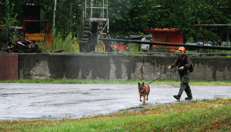 Debbie Palman, a volunteer with Maine Search and Rescue Dogs, helps with a search for Ayla Reynolds on Tuesday morning at the site of the former Scott Paper Mill in Winslow. Ayla was reported missing seven months ago today from her Waterville home.