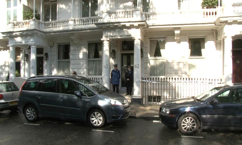 Police gather outside a house in Cadogan Place, Chelsea, after the body of Eva Rausing, one of the richest women in Britain, was found Tuesday.