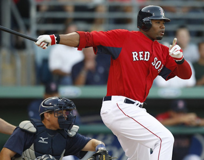 Boston Red Sox outfielder Carl Crawford hits against the Tampa Bay Rays during a spring training baseball game in Fort Myers, Fla. in 2011. The four-time All Star will be playing for the Portland Sea Dogs at Hadlock Field on Tuesday, July 2, as part of a rehab assignment. (AP Photo/Charles Krupa)