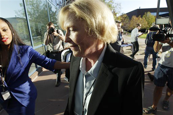 Carol Chambers, Arapahoe County District Attorney, arrives at the county courthouse today in Centennial, Colo., for the first court appearance of James E. Holmes.