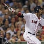 Boston Red Sox's Carl Crawford watches the flight of a fly out to center during the sixth inning of a baseball game against the Chicago White Sox at Fenway Park in Boston, Monday, July 16, 2012. Crawford returned to the line up after being on the 60-day disabled list. (AP Photo/Charles Krupa)