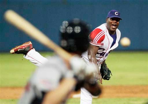 Cuban player Yadier Pedroso throws during a baseball game between a team of collegiate stars representing the United States and a veteran Cuban national squad in Havana, Cuba, on Thursday.