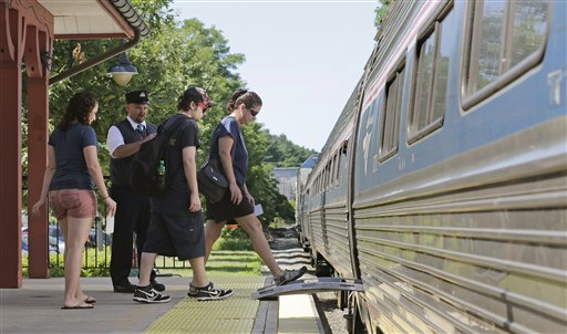 Passengers board Amtrak's Downeaster train at the station in Exeter, N.H. Associated Press photo
