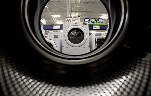 Washing machines on display on a showroom floor at a Lowe's store in Atlanta. Companies cut back on orders for long-lasting U.S. factory goods in January.