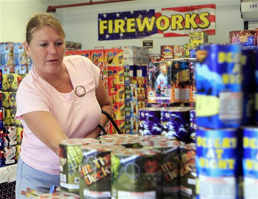 Sheila Grimes of South Berwick, Maine, looks through piles of fireworks at Hilltop Fireworks on Tuesday in Somersworth, N.H.