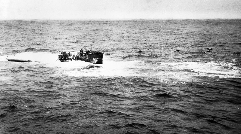 This April 16, 1944, photo shows crewmen of German submarine U-550 abandoning ship in the Atlantic Ocean after being depth charged by the USS Joyce, a destroyer in an Allied convoy that the submarine attacked.