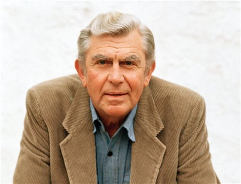 "This March 6, 1987 file photo shows actor Andy Griffith in Toluca Lake, Calif. Griffith, whose homespun mix of humor and wisdom made ""The Andy Griffith Show"" an enduring TV favorite, died Tuesday, July 3, 2012. He was 86. (AP Photo/Doug Pizac, file) Actor;celebrity;hands;folded;posing"