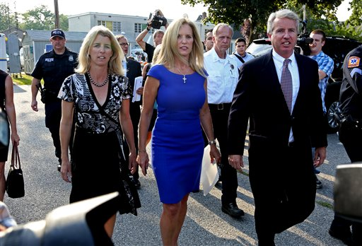 Kerry Kennedy, ex-wife of New York Gov. Andrew Cuomo, is flanked by her brother Christopher Kennedy, right, and sister Rory Kennedy, as she walks from the North Castle Justice Court in Armonk, N.Y., on Tuesday.