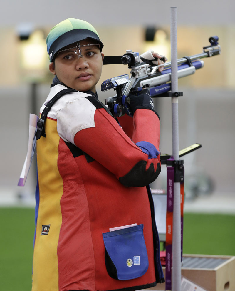 Malaysian shooting athlete Nur Suryani Mohamed Taibi, who is eight months pregnant, trains for the 10-meter air rifle event at the Royal Artillery Barracks, ahead of the the start of the 2012 Summer Olympics.