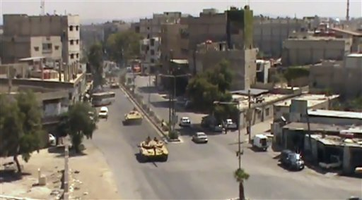 This image made from video provided by Shaam News Network on Tuesday purports to show Syrian tanks in Damascus.