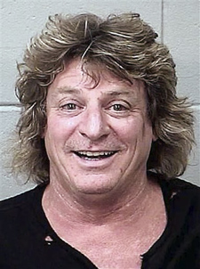 Booking photo of Mick Brown, drummer for classic rocker Ted Nugent. Brown, of Cave Creek, Ariz., was charged with driving drunk in a golf cart stolen from a concert venue in Bangor.