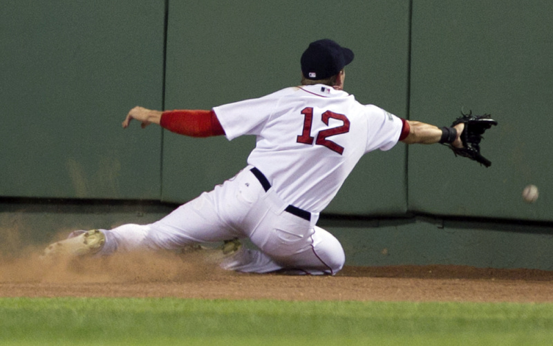 Ryan Sweeney slides toward the wall as he is unable to grab an RBI triple by New York's Alex Rodriguez in the fifth inning Sunday night at Fenway Park. The Yankees won, 7-3.