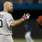 Then-Red Sox third baseman Kevin Youkilis tosses his helmet after grounding out in a game against the Toronto Blue Jays in early June.