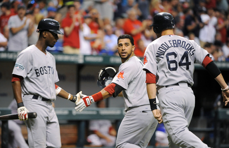 Boston's Pedro Ciriaco, left, celebrates with Mike Aviles, center, and Will Middlebrooks after Aviles and Middlebrooks both scored off Aviles' homer in the second inning against the Tampa Bay Rays Sunday in St. Petersburg, Fla.