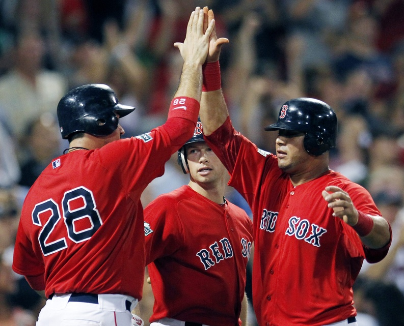 Adrian Gonzalez, Daniel Nava, center, and Mauro Gomez, right, celebrate after Gonzalez and Gomez scored on a three-run double by Pedro Ciriaco that also drove in Cody Ross in the sixth inning of game two against the New York Yankees in Boston on Saturday.
