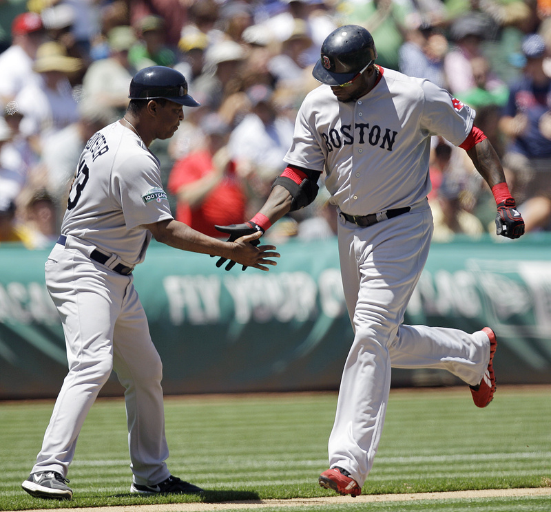 David Ortiz is congratulated by third base coach Jerry Royster after hitting his 400th career home run off Athletics' A.J. Griffin on Wednesday in Oakland.