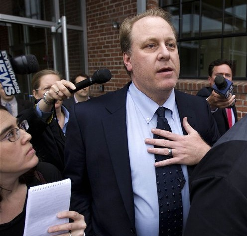 In this Wednesday, May 16, 2012 file photo, former Boston Red Sox pitcher Curt Schilling, center, is followed by members of the media as he departs the Rhode Island Economic Development Corporation headquarters, in Providence, R.I. The failed video game company founded by Schilling is in federal bankruptcy court in Delaware, as work begins to sort out what can be salvaged from a company that says it owes more than $270 million. (AP Photo/Steven Senne, File)