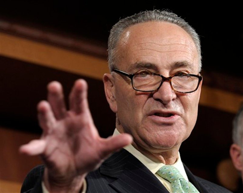 In this May 17, 2012 file photo, Sen. Charles Schumer, D-N.Y. gestures during a news conference on Capitol Hill in Washington. Democrats want to push tax cuts through the Senate for companies that hire new workers, give raises or buy major new equipment this year. With neither party eager to let the other claim campaign-season victories, the ultimate fate of the roughly $29 billion legislation seems dubious. Debate was to begin Tuesday, though it was possible Republicans would use procedural blockades to quickly derail the measure. (AP Photo/Susan Walsh, File)