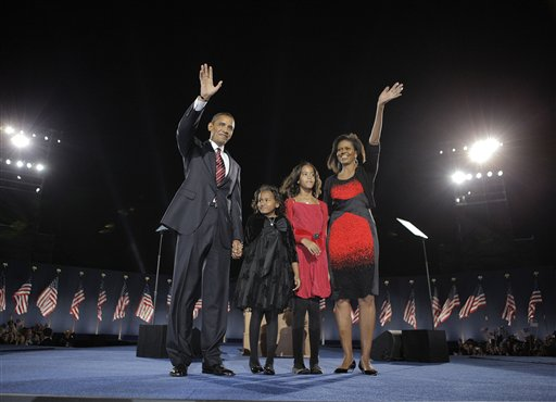 This Nov. 4, 2008 file photo shows President-elect Barack Obama, left, his wife Michelle Obama, right, and two daughters, Sasha, 7, and Malia, 10, second from right, as they wave at the election night rally in Chicago. Sony Electronics and the Nielsen television research company collaborated on a survey ranking TV's most memorable moments. Other TV events include, the Sept. 11 attacks in 2001, Hurricane Katrina in 2005, the O.J. Simpson murder trial verdict in 1995 and the death of Osama bin Laden in 2011. (AP Photo/Jae C. Hong, File)