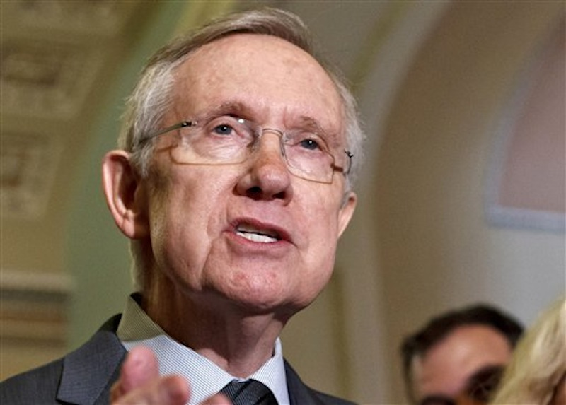 In this June 5, 2012 file photo, Senate Majority Leader Harry Reid, D-Nev. speaks on Capitol Hill in Washington. Uniforms for U.S. Olympic athletes are American red, white and blue _ but made in China. That has members of Congress fuming. Republicans and Democrats railed Thursday about the U.S. Olympic Committee's decision to dress the U.S. team in Chinese manufactured berets, blazers and pants while the American textile industry struggles economically with many U.S. workers desperate for jobs. (AP Photo/J. Scott Applewhite, File)
