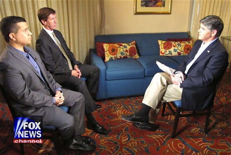 In this photo provided by the Fox News Channel, Fox News Channel host Sean Hannity, right, interviews George Zimmerman, left, and his attorney Mark OíMara, Wednesday, July 18, 2012 at an undisclosed Florida location. Zimmerman has been charged with second degree murder for the Feb. 26, 2012 shooting death of Florida teenager Trayvon Martin. He is claiming self-defense under Floridaís ìStand Your Groundî law. The telecast airs Wednesday at 9 p.m. on the Fox News Channel. (AP Photo/Fox News Channel)