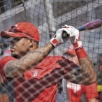 Boston Red Sox outfielder Carl Crawford takes batting practice at Hadlock Field in Portland as he practices with the Portland Sea Dogs Monday, July 2, 2012. Crawford said a fan yelled a racial slur at him while playing with the Sea Dogs in New Hampshire earlier this week.