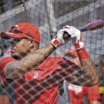 Boston Red Sox outfielder Carl Crawford takes batting practice at Hadlock Field in Portland as he practices with the Portland Sea Dogs Monday, July 2, 2012. Crawford's rehab has been temporarily put on hold after suffering a groin strain in Portland.