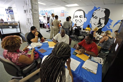 In this photo taken June 28, 2012, President Barack Obama 2012 volunteers have a meeting at campaign headquarters in Richmond, Va. Call them passionate, idealistic, earnest, even a tad naive: The volunteers helping to power the Obama and Romney campaigns are outliers at a time when polls show record low public satisfaction with government and a growing belief that Washington isn�t on their side. While motivated by opposing goals, the Obama and Romney volunteers share at least one key trait: an abiding faith in the political process and a belief that it still matters who occupies the White House. (AP Photo/Steve Helber)