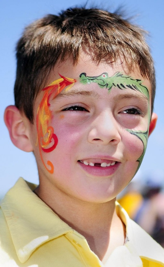 Dominick Dow sports a dragon tattoo in face paint at the Whatever Family Festival Kid's Day events on Saturday afternoon.