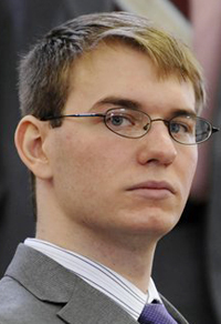 In this April 9, 2012 photo,Thayne Ormsby sits in Superior Court, in Houlton, Maine. Ormsby was found guilty of murdering two men and a 10-year-old boy. (AP Photo/The Bangor Daily News, Kevin Bennett)