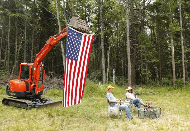 Rick and Maggie Morgan of Hampstead, N.H., watch the Chebeague Fourth of July parade from their island property where they are building a house. The Morgans were also celebrating their wedding anniversary on Wednesday.