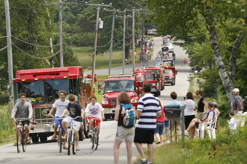 "The Fourth of July parade rolls through Chebeague Island Wednesday as residents celebrate the holiday and a ""ship-crews-come-home-to-family"" tradition that began in the mid-1800s."