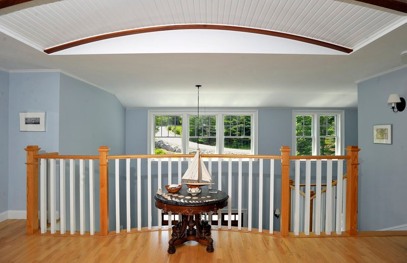 The pleasant upstairs foyer boasts curves and color.