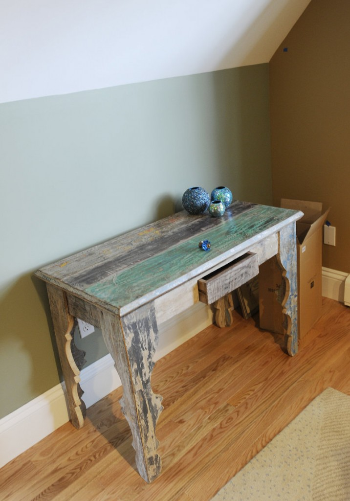 A table made in India of recycled wood sits in a family entertainment room decorated by Sue Bartlett.